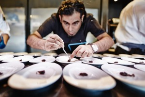 Chef Gaggan Anand plates for service.