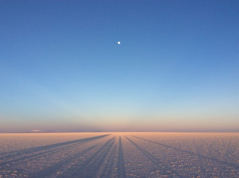 The Salt Flats of Uyuni, Bolivia. Taken on 14 September 2016. The setting sun casts full shadows of our group onto the ...
