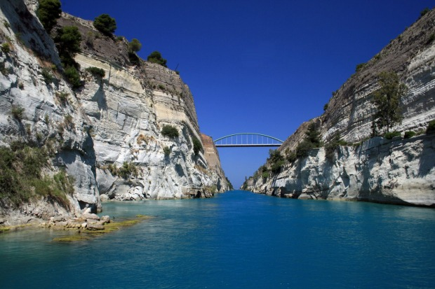 CORINTH CANAL, GREECE. Only very slim vessels can sail through the Corinth Canal because it is just 21.3 metres wide. ...