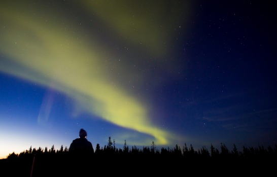 A women views the Northern Lights, known as aurora borealis, in Yellowknife, Northwest Territories, Canada.