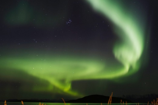 The aurora borealis, or Northern Lights, over the Norwegian town of Harstad.