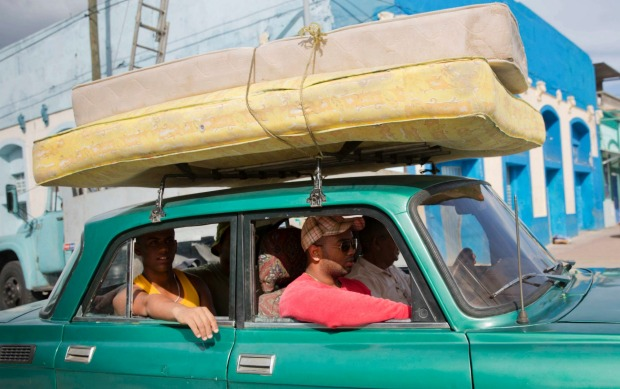 A car carrying mattresses heads towards a shelter prior the arrival of the Hurricane Matthew in Santiago, Cuba in ...
