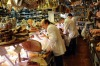 Customers are served at the Volpetti delicatessen in the Testaccio area of Rome, Italy.