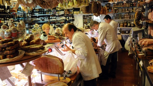 Customers are served at Volpetti delicatessen in the Testaccio suburb of Rome.