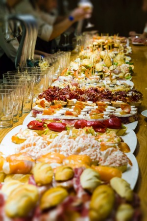 Pintxos (Spanish snacks) on the counter of the tapas bar in the gastronimical capital of Spain - San Sebastian.