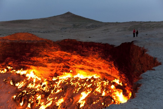 THE PLACE: Door to Hell, Turkmenistan. Almost 50 years ago, the collapse of a natural gas field formed a 30-metre-deep ...