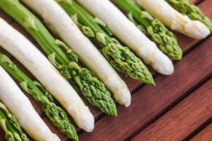 Green asparagus on wooden table in Saxony, Germany.