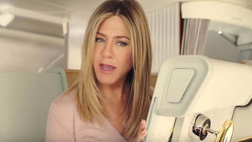 Jennifer Aniston finds a little surprise in her first class seat.