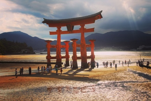 This photo was taken at Miyajima Island in the afternoon on a humid day. The light through the clouds and the shadows of ...