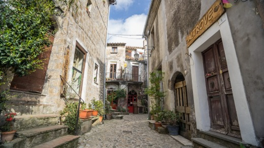 Calcata is a rabbit warren of cobbled streets, with tiny stone houses piled one on top of the other.