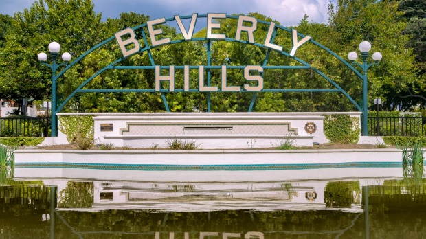 Beverly Gardens Park, next to Rodeo Drive. You can see the much-photographed 12-metre illuminated Beverly Hills sign there.