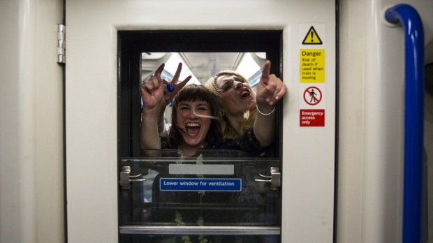 Revelers in a carriage on the Victoria line.