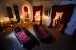 Two coffins are lit before a photo shoot in Bran Castle, in Bran, Romania. Airbnb has launched a contest to find two ...