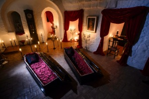 In this picture taken Oct. 9, 2016, two coffins are lit before a photo shoot in Bran Castle, in Bran, Romania. Airbnb ...