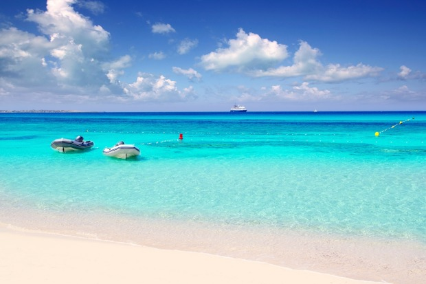 A tropical beach with turquoise water on Formentera island.