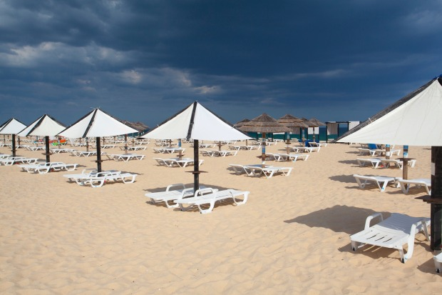 Sun lounges on Tavira beach, Portugal.
