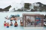 Tourists drinking and socialising at a pool bar in Iceland's Blue Lagoon.