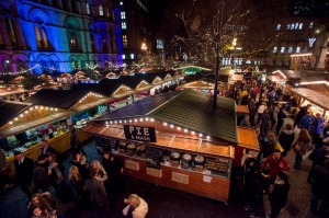 Manchester's Christmas Market with food stalls, bars, Christmas decorations and gift stalls.