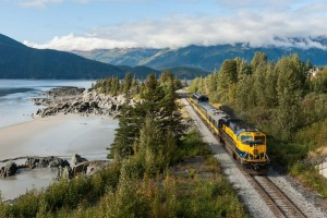 The Alaska Train travelling along the shores of Turnagain Arm near Girdwood.