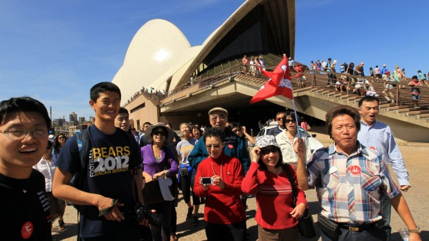 Chinese tourists on a tour of the Sydney Opera House.