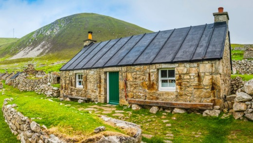 A renovated stone cottage among the village ruins on Hirta.