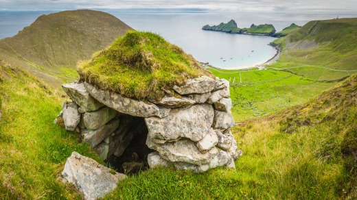 A traditional stone cleit, or store room, on Hirta. The turf roof keeps the rain off the peat, seabirds and grain stored ...
