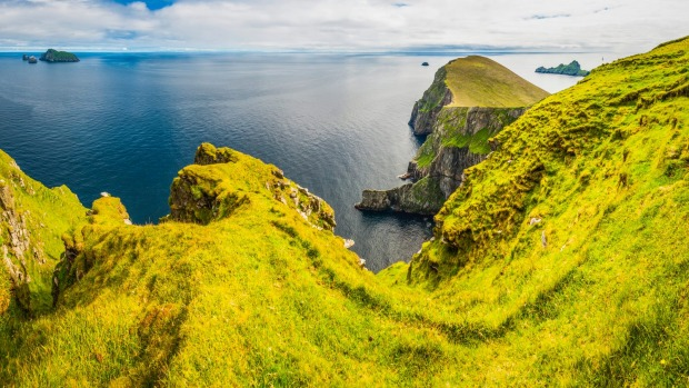 The green pastures and cliffs of St Kilda.