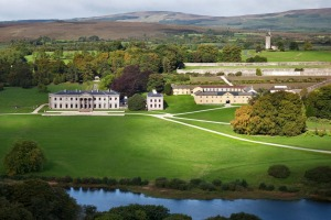 Ballyfin House is surrounded by lush, manicured gardens.