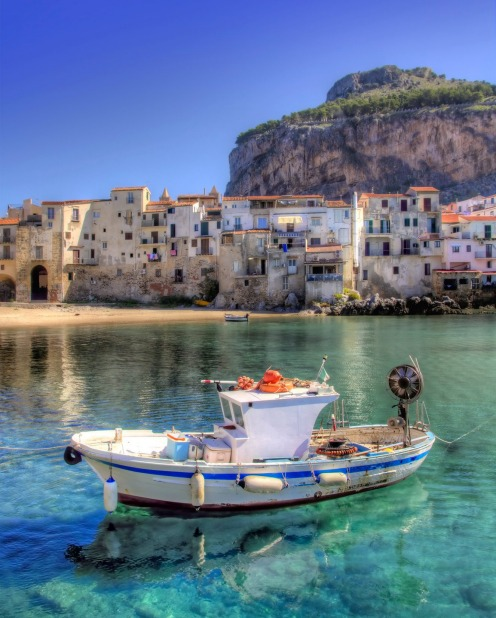 Boat moored in the port of Cefalu, Sicily.
