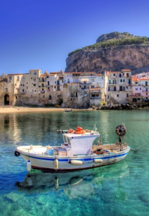 A boat moored in the port of Cefalu, Sicily.