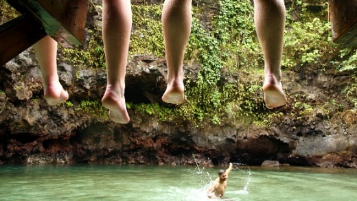 Visitors swim in the To Sua Ocean Trench in Lotofaga, Samoa.