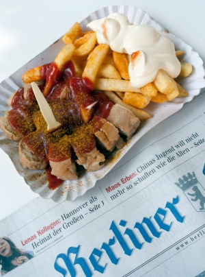 Traditional Berlin currywurst snack at famous Konnopke`s currywurst stall in Prenzlauer Berg.