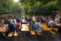 Beer garden in summer at Cafe am Neuen See in Tiergarten park.