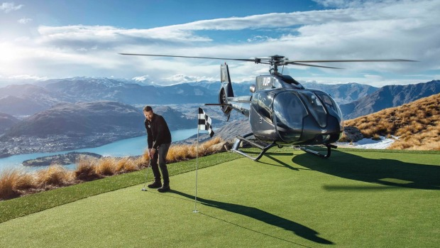 Extreme golf, anyone? A chopper conveys golfers to the green on Cecil Peak.