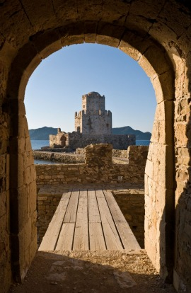 Looking through the main sea gate of Methoni fortress towards the Bourtzi tower, Methoni, Messinia, Southern ...