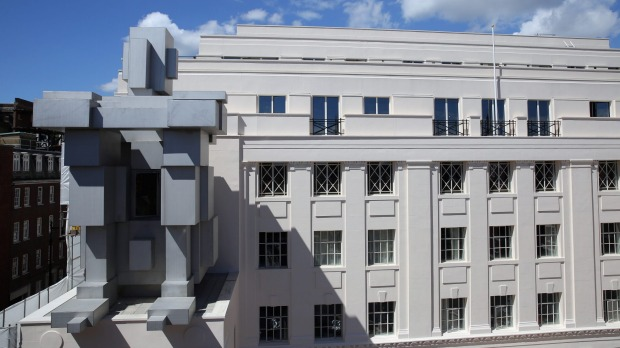 British artist Anthony Gormley's <i>Room</i>, which comprises a crouching figure on the facade of the Beaumont Hotel in ...