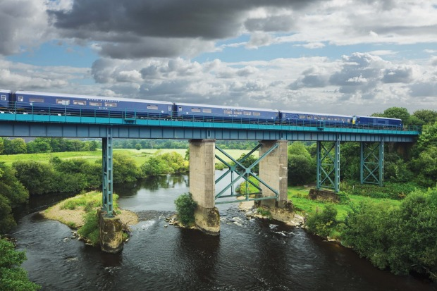 the Belmond Grand Hibernian on the line to Cork crossing the River Blackwater at Mallow, Co Cork.