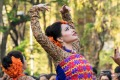 Festival dancers celebrate the arrival of spring in India.