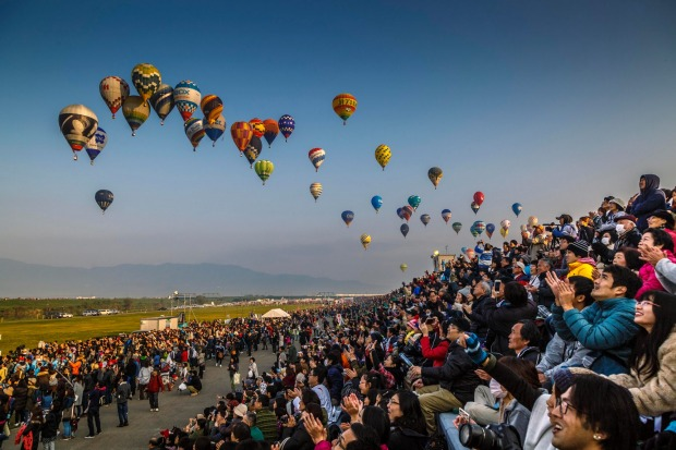 Competitors at the World Hot Air Ballooning Championships in Saga, Japan come in to the target in front of over 100,000 ...