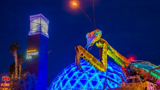 A giant praying mantis welcomes you to Downtown Container Park.