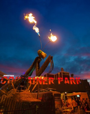 A night view of the Container Park in Downtown Las Vegas. The giant praying mantis sculpture shoots fire at night.