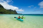 Paddling the crystal blue waters towards Bali Hai.