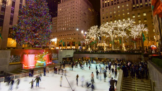 Tourists and skaters get in the Christmas spirit at New York's Rockefeller Centre.