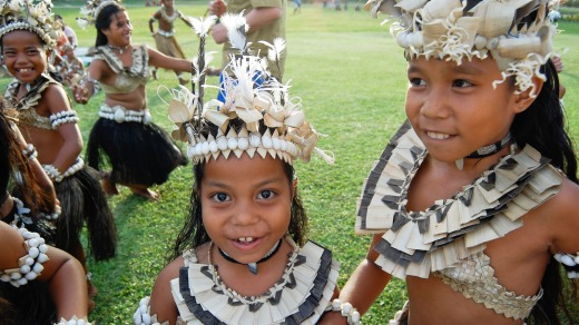 Local children participate in a Historical Village Dance, Fiji.