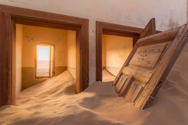 Kolmanskop is a ghost town in the Namib desert in southern Namibia.The effects of wind, sand and time allow the creation ...