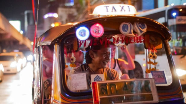 See, smell and taste Bangkok from the back of a tuk-tuk.