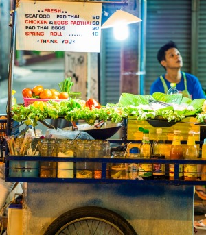 A food cart stocked with ingredients for making pad Thai.