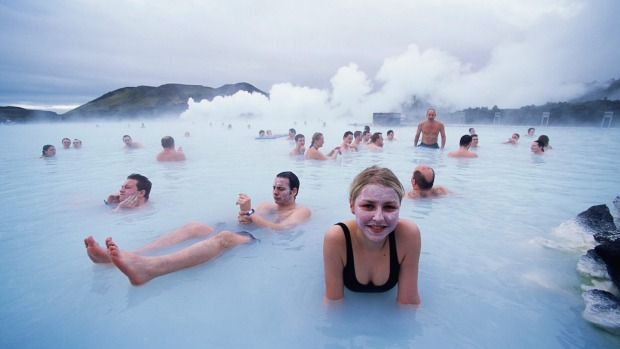 People relax in the Blue Lagoon, a natural geothermal field which gets its colour from the white silica mud and blue algae.