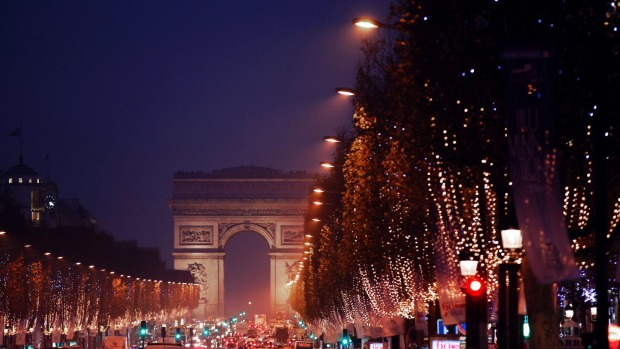 christmas lights along the champs elysees in paris which is one of the top three - Best European Cities For Christmas