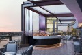 """Designed by Cox Architecture, the hotel's big """"wow"""" factor is the rooftop bar – the CBD's only premium hotel rooftop bar ..."""